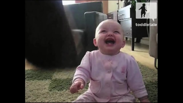 Baby girl laughs uncontrollably as she watches her dog eating popcorn
