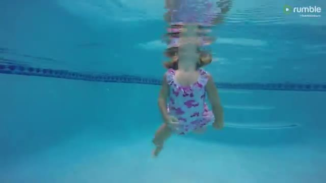 Two-year-old swims in pool all by herself