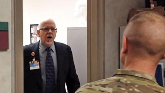 Doctor breaks down into tears when soldier son surprises him at work