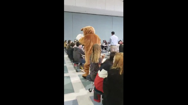 Mascot surprises middle school students at lunch, then reveals his true identity