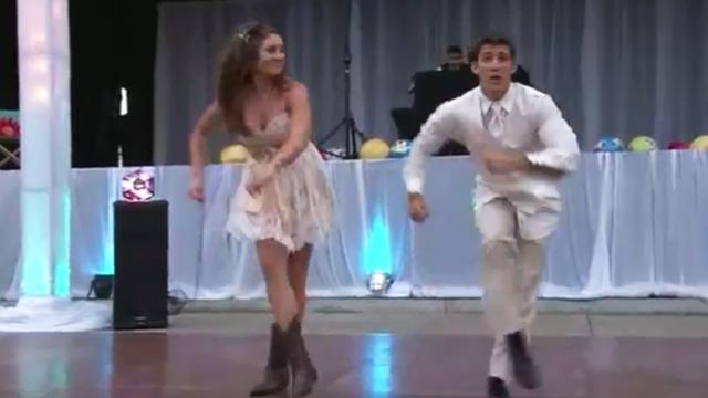 Newly weds put on fun dance performance for wedding guests