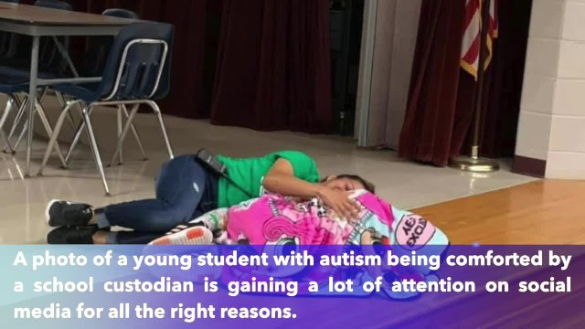 Mom shares sweet photo of school custodian comforting daughter with autism