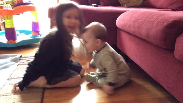 Sister and her lil Brother were just Playing on the Floor, when Mom Captures this Sweet Moment