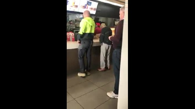 Man approaches elderly man struggling at McDonald's register only doesn't notice he's on camera