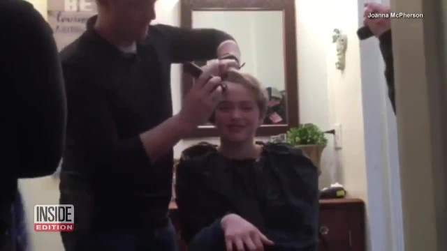 Young daughters shave off all their hair for Air Force mom battling breast cancer