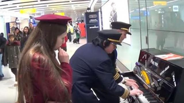 2 pilots barge in on school girl playing piano only to have her jump back in and join them