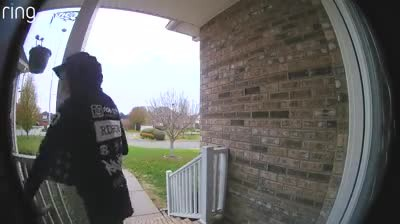 Hooded man stands at woman's front door leaving her aghast when his intentions caught on camera