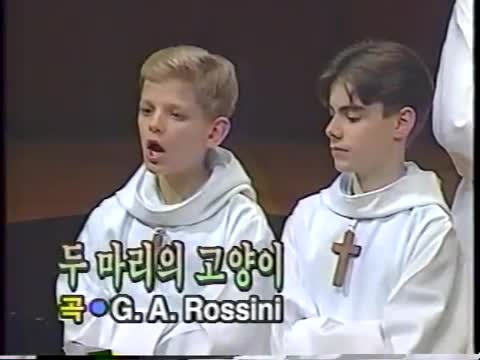 Church choir lines up to start, then crowd bursts into laughter when boy sings first note