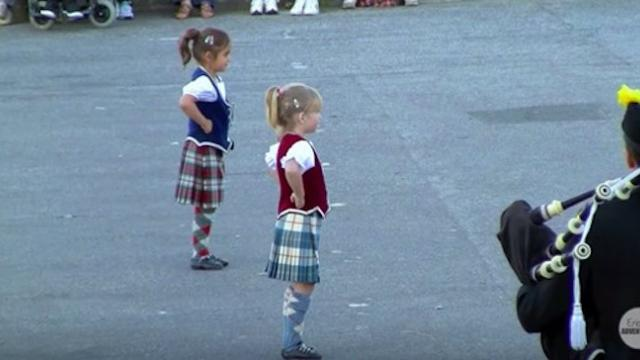 Tiny girls prepare to dance, instant music starts crowd can't take their eyes off their feet
