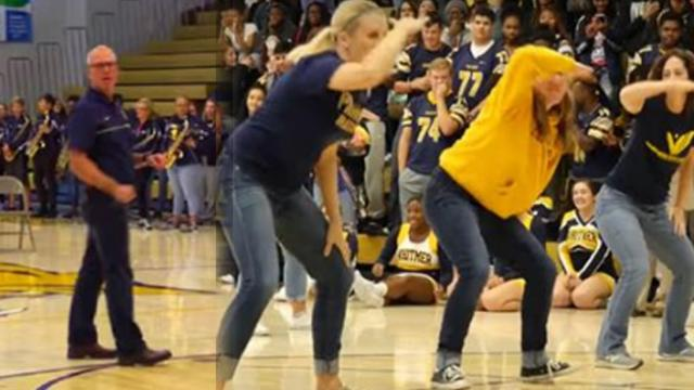 Principal's speech is shutdown when teachers storm the stage to put on an epic routine