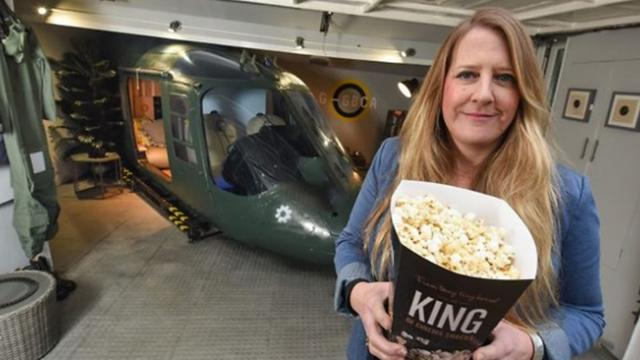 Mother transforms an old Army helicopter into a home cinema
