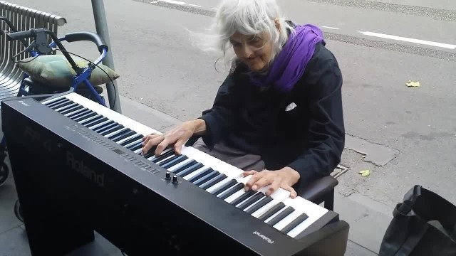Elderly woman sits down to play street piano and it sounds straight from heaven
