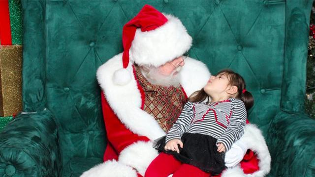 Rhode Island girl, 4, with cerebral palsy falls asleep in Santa's arms at mall