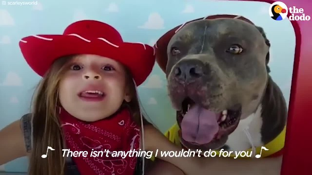 Little girl sings to her Pit Bull (and melts even the coldest hearts)