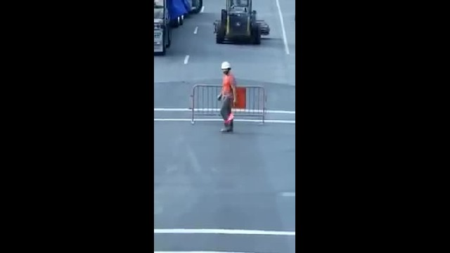 Construction Worker Has Motorists Dying Laughing With Hysterical Moves At Detour