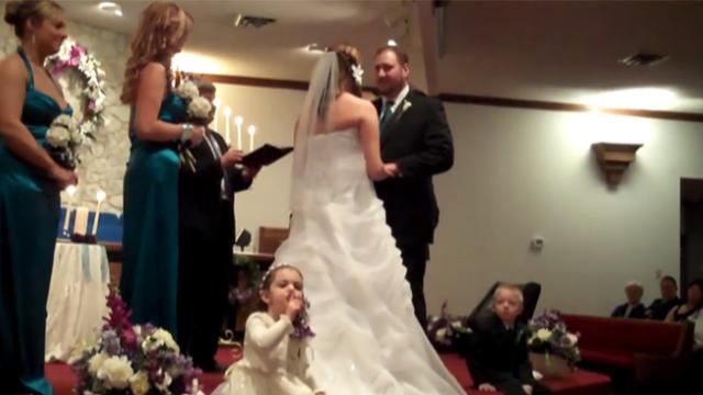Adorable flower girl shows her bossy side by shushing guests