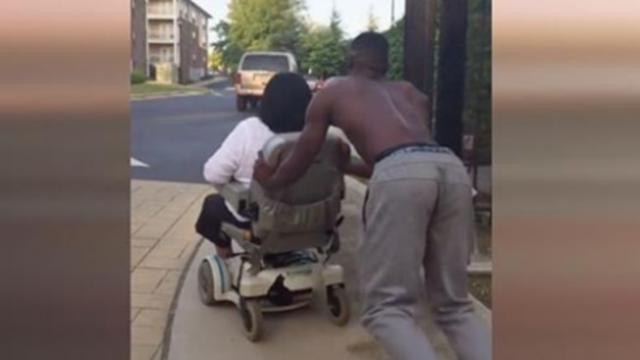 Video of a man pushing a woman one mile home after wheelchair breaks down is going viral