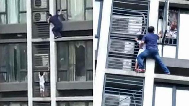 Heart-stopping moment father climbs out of a seventh-floor window to rescue his stuck son who climbe