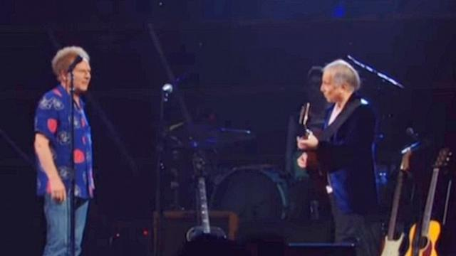 They've been fighting for 50 years, so the crowd erupted when Garfunkel confronted Simon on stage