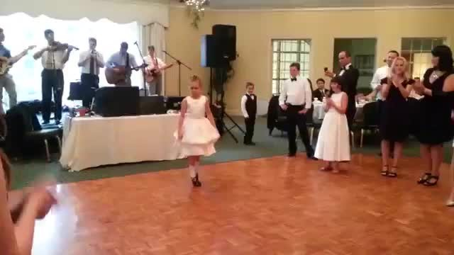 Girl Irish dances at wedding, then baby brother comes running in to steal the show