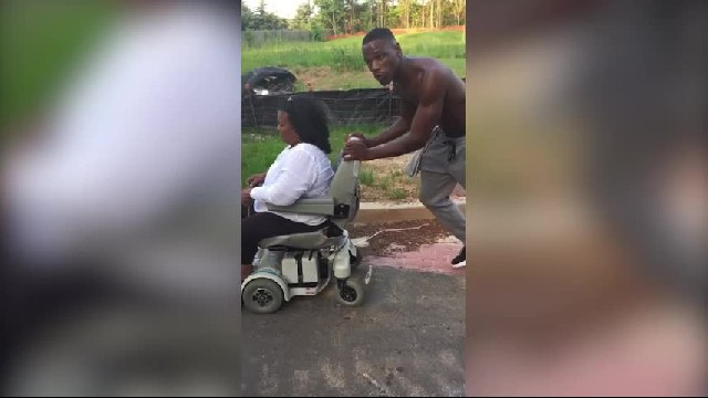 Man sees elderly woman's wheelchair break down, decides it's a perfect opportunity