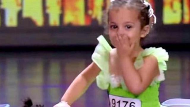 Four-year-old girl and tiny dog enter stage with delightful act that has audience on feet wildly app