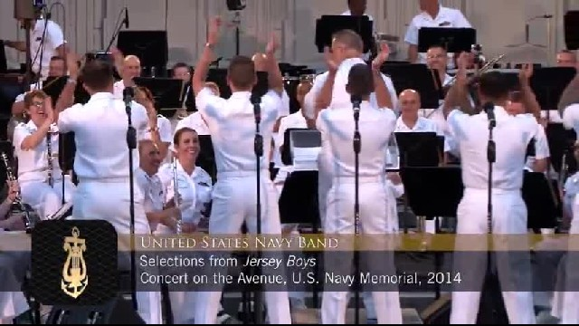 5 navy men stand onstage, they look up and crowd goes wild as they serenade with songs from 60s
