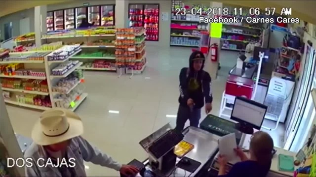 Watch cowboy single-handedly take down armed robber in convenience store