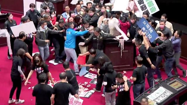 Fists and pig guts fly in Taiwan's parliament