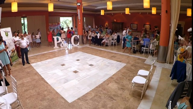 Groomsmen line up before bride but when little brother comes out he steals the show