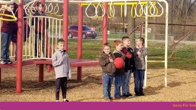 Picture of young boys paying respect for the National Anthem goes viral