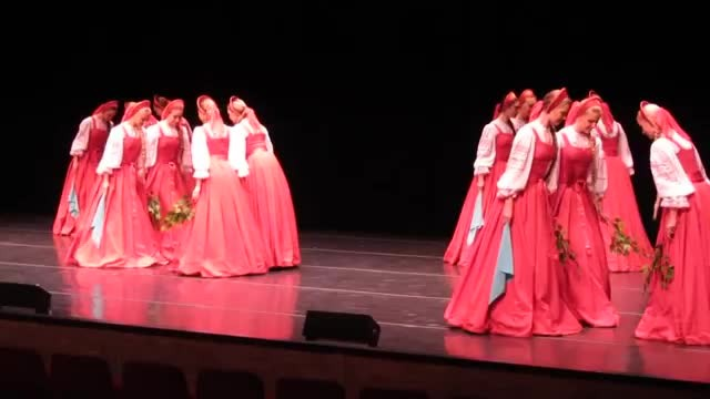 16 Russian dancers form a line on stage leaving crowd open mouthed when they begin to move in unison