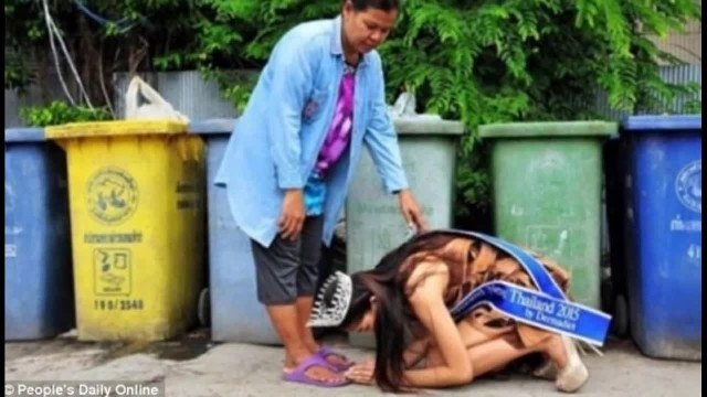 Thai pageant queen kneels before her 'garbage collector' mother to thank her for raising her