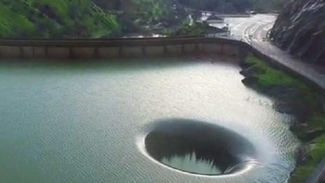 Hole in lake sparks curiosity, so man flies drone inside & captures