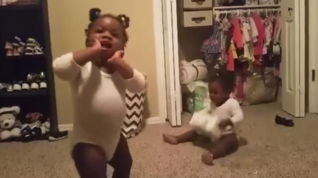 Twin baby girls are the epitome of happiness as they dance to their favourite song