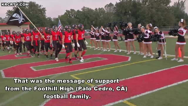 Football team leaves cheerleader speechless when they toss these at her feet before game