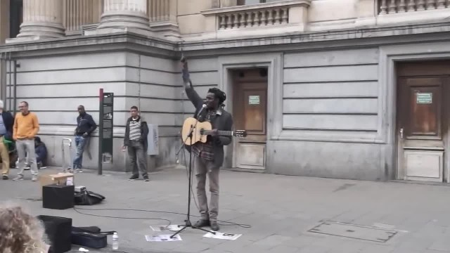 Busker Was Singing A Bob Marley Classic, Woman He's Never Met Joins Him & Drops His Jaw