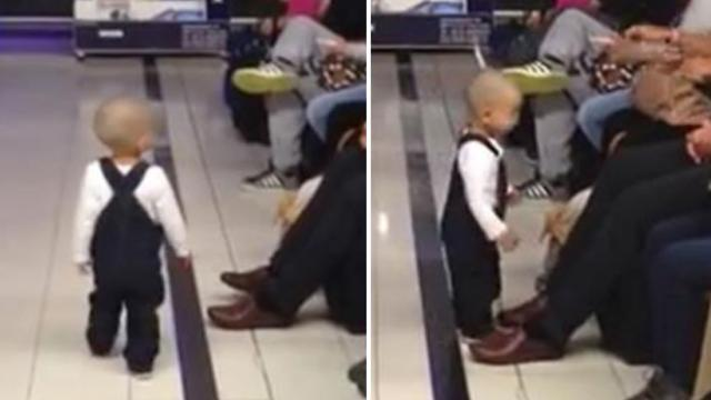 Adorable baby roams airport, then turns to unexpectedly brighten stranger's day.