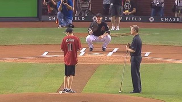Blind teenager throws first pitch at baseball game and the crowd goes wild as he nails it