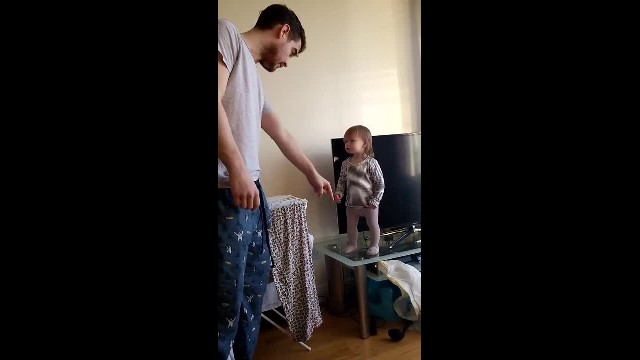 Adorable daddy-daughter standoff