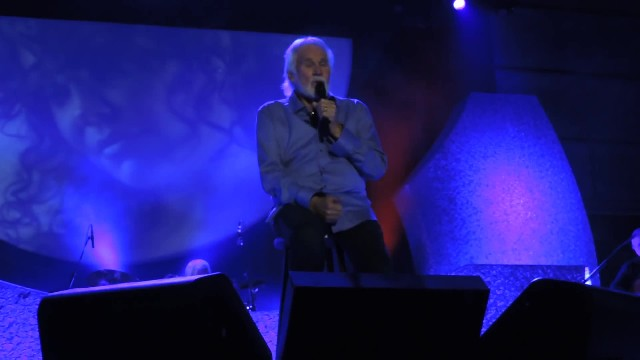 Kenny Rogers watches with pride as his twin boys join him on stage for a song