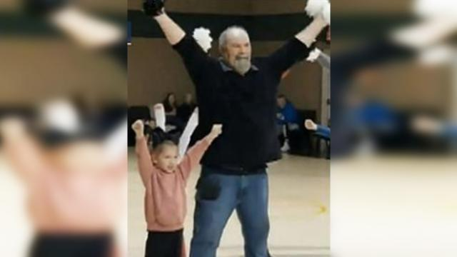 Scared little girl freezes during recital, so grandpa jumps up to dance with her.