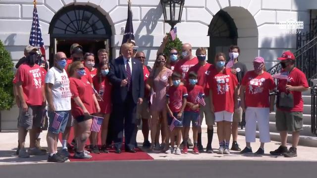 President Trump participates in a greeting with the walking marine, Terry Sharpe