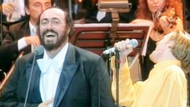 Bryan Adams sings Italian opera with Pavarotti who has a hard time containing his laughter
