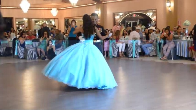 Father and daughter bust out dance moves during party