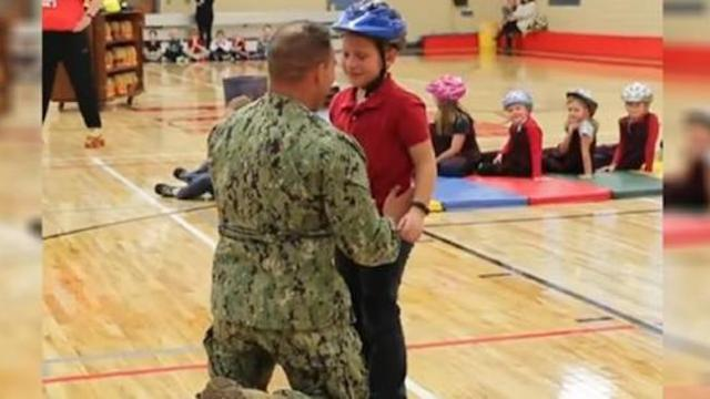 Navy dad is away from family for 20 months, then shows up at 7-year-old son's school unannounced