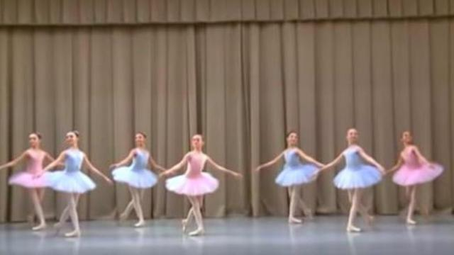 7 delicate ballerinas stand frozen on stage leaving crowd spellbound moment their feet start to move