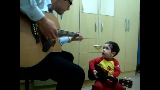 Dad Plays Beatles Classic On His Guitar, Turns To 1 Yr Old Son Who Opens His Mouth & Takes Over