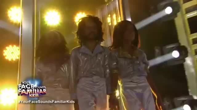 3 young boys dress like bee gees making everyone's mouth fall open moment they start to sing