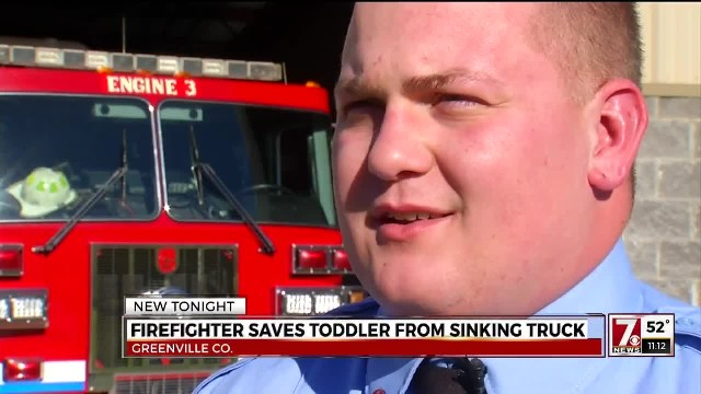 Off-duty fireman sees frantic man beside pond. When he sees why, he dives in immediately
